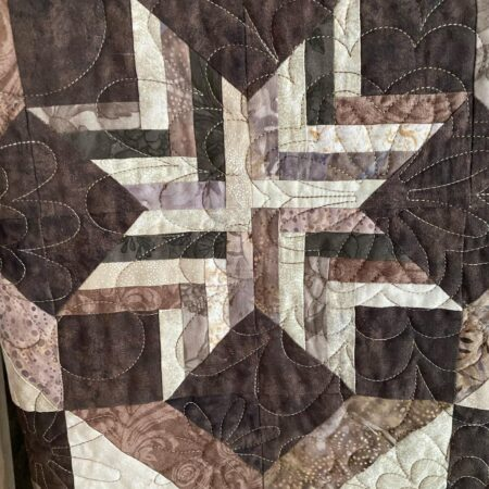 quilt made using the paperpieci method.